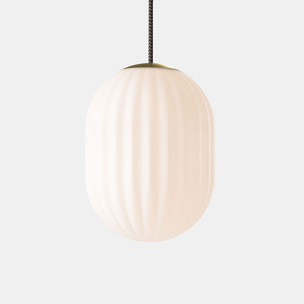 Bright Modeco Plus pendant with a black textile cable and a solid brass top