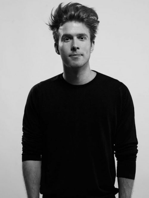 Black and white portrait of architect and designer Jonas Hoejgaard in a black shirt