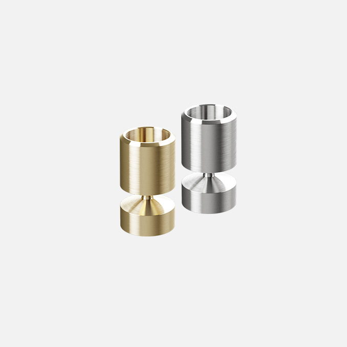 Manchet Candleholders, made from solid brass and stainless steel