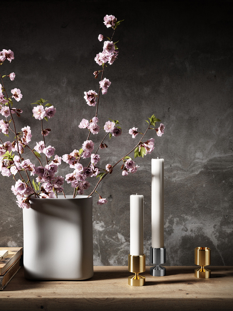 Three manchet candleholders, two in brass and one in stainless steel and a Japanese cherry branches
