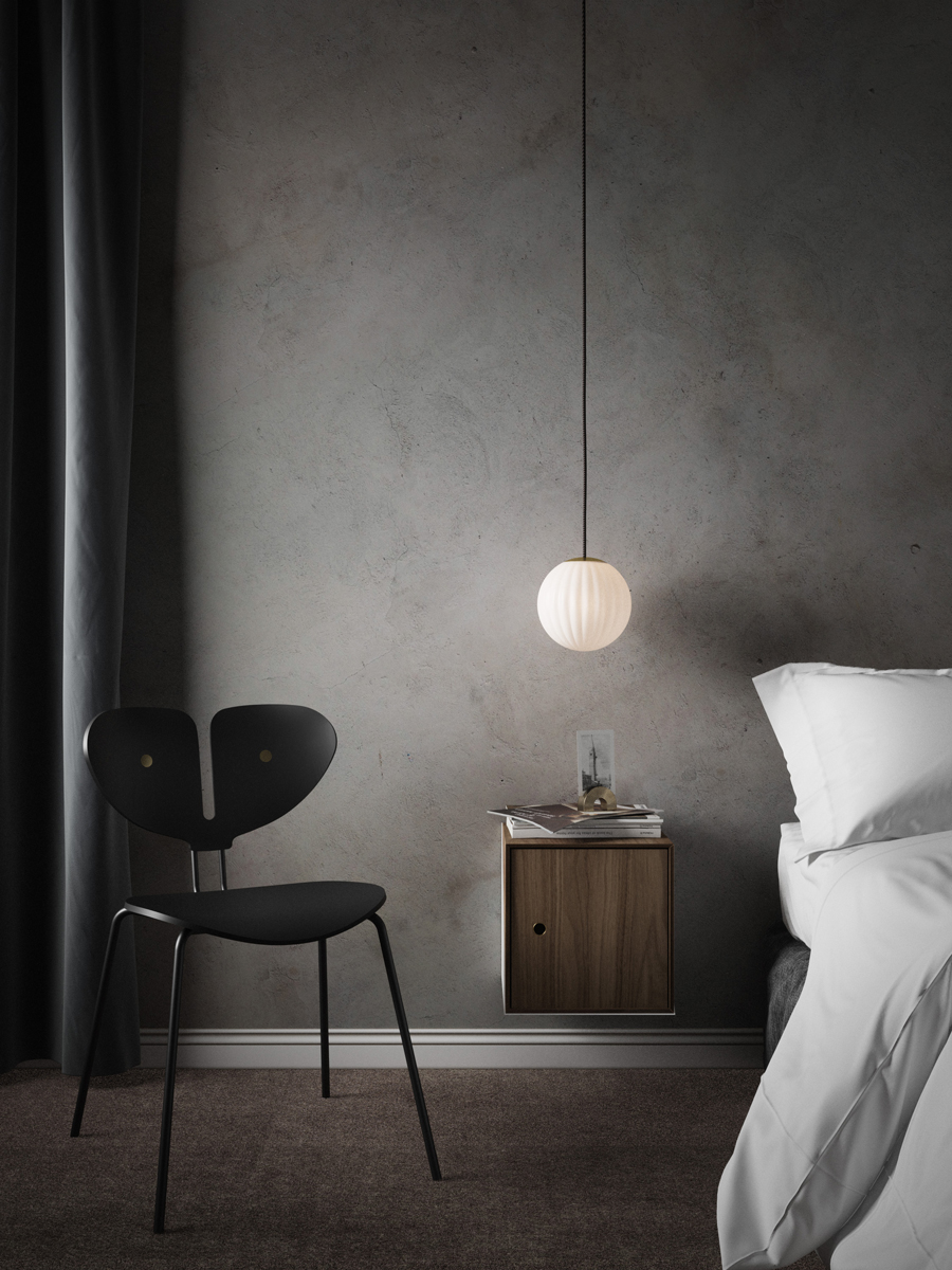 Bright Modeco accompanied by a Black Moth chair in a grey scandinavian bedroom